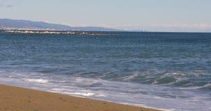 Barcelona sunny day beach waves panoramic city view 4k spain. Spain barcelona sunny day beach waves panoramic city view 4k stock footage