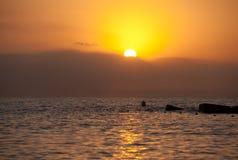 Barcelona sunrise from Barcelonetta beach. Barcelona sunrise over sea from Barcelonetta central beach stock photos