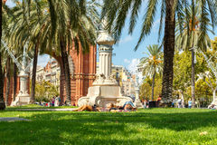 Barcelona. Triumphal Arch. Barcelona, Spain - September 6, 2015: People relaxing on the lawn near the Arc de Triomphe in Barcelona. The arch was built for the Stock Photo