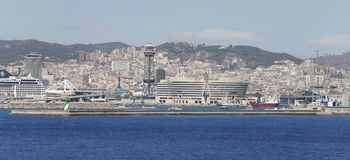 Barcelona view from the seaport wide view. Maritime facade of the city of Barcelona with recreational seaport on first term and some city attractions and stock images