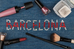 Barcelona. The world capitals of fashion. Word inlaid rhinestones and cosmetics. Stock Photos