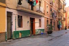 Barceloneta, Barcelona, Spain. A scene of a narrow pedestrian street in La Barceloneta, a neighborhood in Barcelona, Spain. Build in the 18th century it is still Stock Images