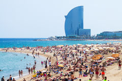 Barceloneta Beach against W Barcelona Hotel. BARCELONA, SPAIN - JUNE 28: Barceloneta Beach against W Barcelona Hotel in June 28, 2013 in Barcelona, Spain Royalty Free Stock Image
