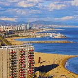 Barceloneta Beach in Barcelona. Aerial view of Barceloneta Beach and cityscape of Barcelona, Catalonia, Spain Stock Images