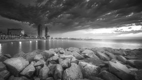 Barceloneta Beach in Barcelona at sunrise. Barceloneta Beach in Barcelona with colorful sky at sunrise . Black and white concept Royalty Free Stock Photos