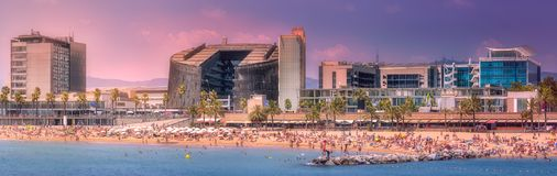 Barceloneta Beach in Barcelona at purple sunset. Aerial view of Barceloneta Beach with many people during purple sunset in Barcelona, Spain Royalty Free Stock Photo