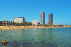 Barceloneta Beach in Barcelona, Spain. BARCELONA, SPAIN - AUGUST 16: Barceloneta Beach with Hotel Arts and Mapfre Tower in the background on August 16, 2011 in Royalty Free Stock Photo