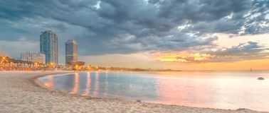 Barceloneta Beach in Barcelona at sunrise Royalty Free Stock Photo