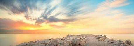 Barceloneta Beach in Barcelona at sunrise. Barceloneta Beach in Barcelona with colorful sky at sunrise Stock Photography