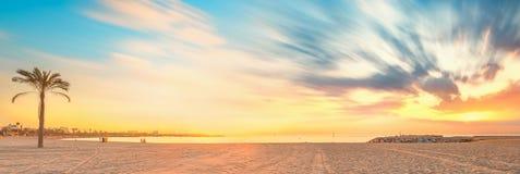Barceloneta Beach in Barcelona at sunrise. Barceloneta Beach in Barcelona with colorful sky at sunrise Stock Photos