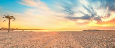 Barceloneta Beach in Barcelona at sunrise. Barceloneta Beach in Barcelona with colorful sky at sunrise Royalty Free Stock Image