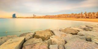 Barceloneta Beach in Barcelona at sunrise. Barceloneta Beach in Barcelona with colorful sky at sunrise Stock Image