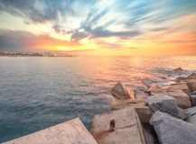 Barceloneta Beach in Barcelona at sunrise. Barceloneta Beach in Barcelona with colorful sky at sunrise Stock Photo