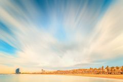 Barceloneta Beach in Barcelona at sunrise. Barceloneta Beach in Barcelona with colorful sky at sunrise Stock Images
