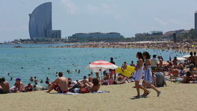Barceloneta Beach and Hotel Vela in summer stock footage