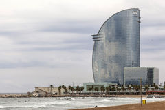 Barceloneta beach and Modern architecture, Hotel W or Hotel Vela, by architect Ricard Bofill. Royalty Free Stock Images
