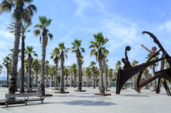 The Barceloneta beach. Tourists enjoy the sunny weather and walking on the promenade along the Barceloneta beach on 9 August 2014 in Barcelona, Spain. This is Stock Photo