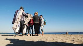 Barceloneta beach with young group of people stock video footage