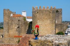 Barcelos Rooster. Obidos, Portugal. Rooster of Barcelos Galo de Barcelos on a medieval wall in Obidos. Portugal Royalty Free Stock Photos