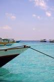 Barche di legno teathered dalle corde Fotografia Stock Libera da Diritti