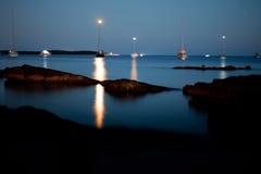 Barche di luce notturna Immagini Stock