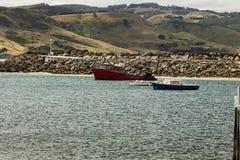 Barche e colline Fotografia Stock