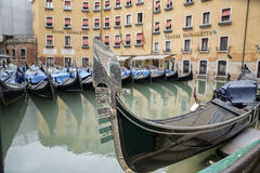 Barche Gondole Venezia. The gondola is a traditional, flat-bottomed Venetian rowing boat, well suited to the conditions of the Venetian lagoon stock images