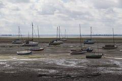 Barche nella marea bassa Immagine Stock