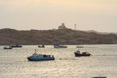 Barche in paesino di pescatori Fotografie Stock