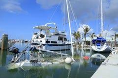 Barche subacquee a Boca Chica Marina Key West Florida dopo Hur fotografia stock libera da diritti
