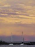 Barche a vela al crepuscolo Immagine Stock