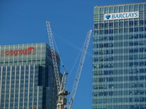 Barclays Bank and Citigroup offices - London UK. Finance offices in London`s Docklands with tower crane in foreground Royalty Free Stock Photos