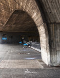 Barclays bicycle under a bridge in London, UK Stock Photography
