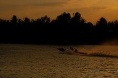 Barco atado largo en la puesta del sol Imagen de archivo