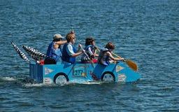 Barco azul del cartón de la leche del coche de carreras Imágenes de archivo libres de regalías