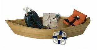 Barco com artes de pesca e veste de vida Fotografia de Stock Royalty Free