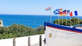 Barco com bandeiras Portugal, o Algarve Foto de Stock Royalty Free