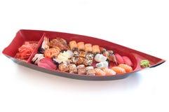 Barco con el sushi fotografía de archivo libre de regalías
