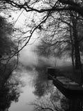 Barco de canal en la niebla Fotografía de archivo