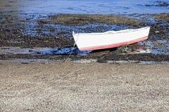 Barco de fila en la playa Imagen de archivo