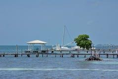 Barco de la costa del calafate de Caye imagen de archivo libre de regalías