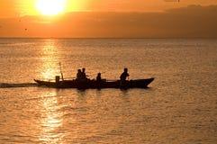 Barco de la puesta del sol Foto de archivo libre de regalías