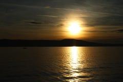 Barco de la puesta del sol Imagen de archivo libre de regalías