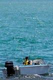 Barco de pesca con el pescador Imagenes de archivo