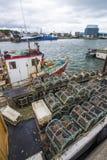 Barco de pesca con los potes de cangrejo Imágenes de archivo libres de regalías