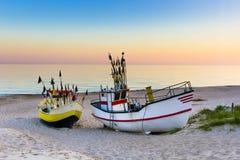 Barco de pesca en la salida del sol Imágenes de archivo libres de regalías