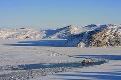 Barco de pesca furado no gelo Foto de Stock Royalty Free