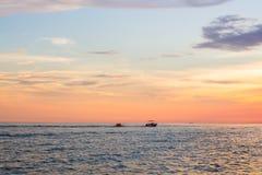 Barco de plátano en el mar Imagenes de archivo