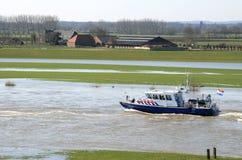 Barco de policía holandés en el río Imagen de archivo libre de regalías