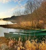 Barco de rowing en las cañas Imágenes de archivo libres de regalías